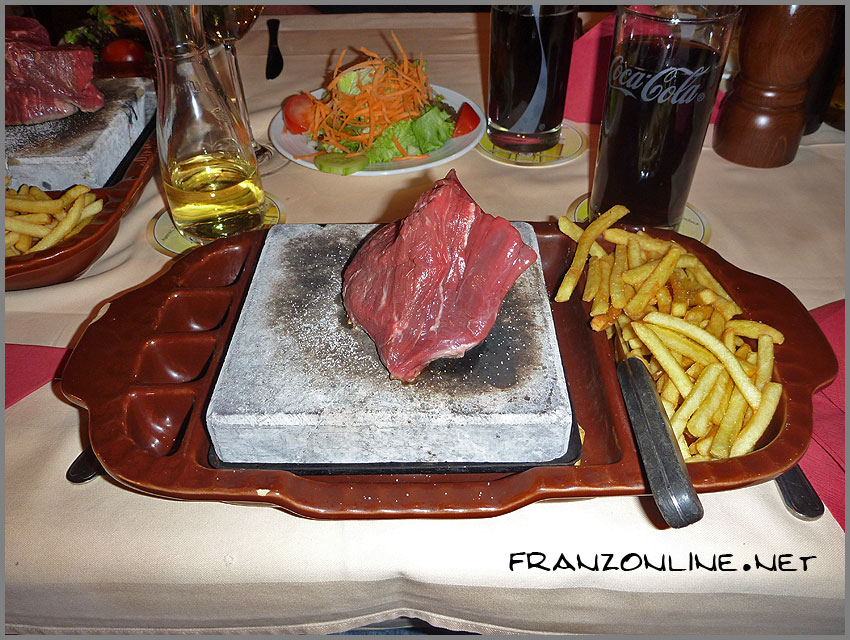 The famous Pistenklause steak on a rock